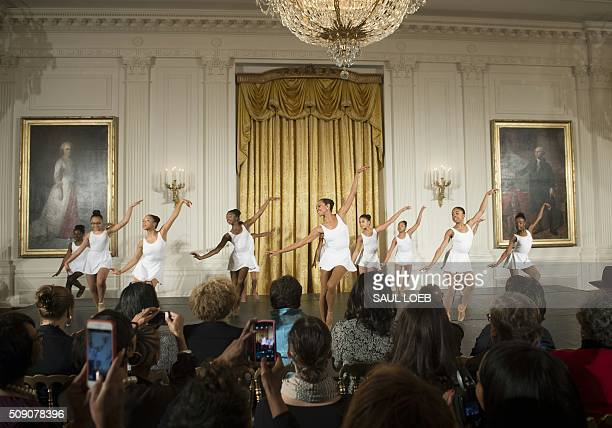Local students perform for US First Lady Michelle Obama at the end of a daylong dance workshop to highlight contributions African American women have...