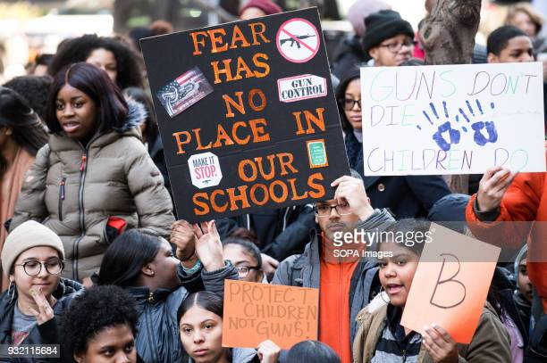 Local students seen holding placards during the National School Walkout a 17 minute walkout by students in honor of the 17 people who died one month...