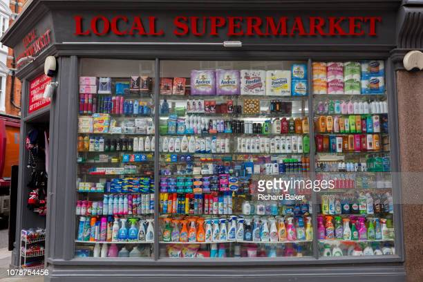 A local supermarket window display showing the retail products being sold in a Kensington convenience store on 30th December 2018 in London England