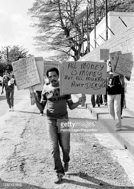 Local supporters protesting at the selection of David Murray of Barbados instead of Trinidad captain Deryck Murray as wicketkeeper for the West...