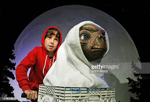 Local Sydney BMX rider Lachlan Stewart reenacts the iconic scene from the Steven Spielberg movie classic ET The ExtraTerrestrial during an unveiling...