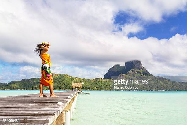 Local tahitian woman on jetty, Bora Bora lagoon