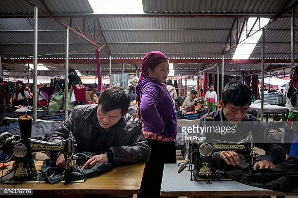 Local tailors fix customers' clothes at Dong Van Sunday Market one of the furthest market up north near the border with China in the mountainous...