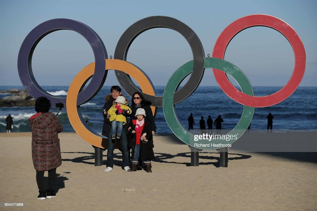 Local' take selfies with the Olympic Rings on the beach at Gangneung ahead of the Pyeongchang 2018 Winter Olympics on January 12, 2018 in Pyeongchang-gun, South Korea.
