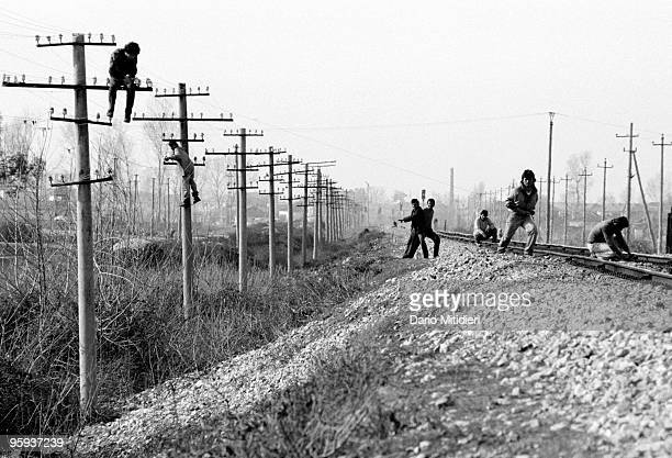 Local technicians repairing electrical lines near Tirana following the fall of the Communist regime in 1991 During this period Albanian society...