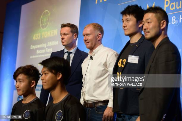 Local teenage football talents Jamie Yau and Matt Chan pose with Global Legends Series CEO James Davies Yandle former Manchester United and England...