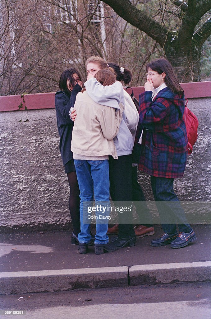 Local teenagers support each other after the massacre at Dunblane Primary School in Scotland, in which 17 people were killed, 17th March 1996.