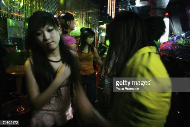 Local teens enjoy the hip and cool scene at the new disco 'Babila Club' on August 5 2006 in Lhasa of Tibet Autonomous Region China Lhasa's face is...
