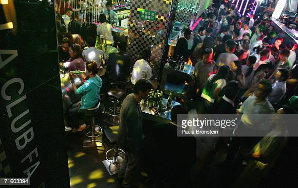 Local teens enjoy the hip and cool scene at the new disco 'Babila Club' in the new part of Lhasa city on August 4 2006 in Lhasa of Tibet Autonomous...