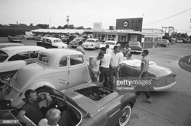 Local teens hang out in the parking lot of an AW drivein restaurant Hutchinson Kansas August 1959 This image was part of an article called 'Kansas...