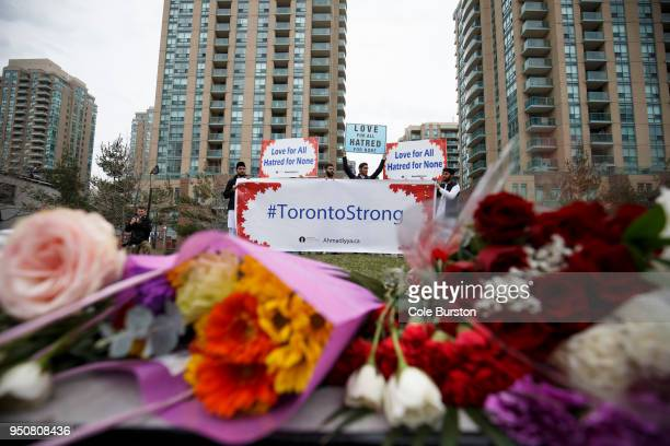 A local Toronto muslim group holds up signs for love and courage for victims of yesterdays crash at memorial on Yonge St at Finch Ave on April 24...