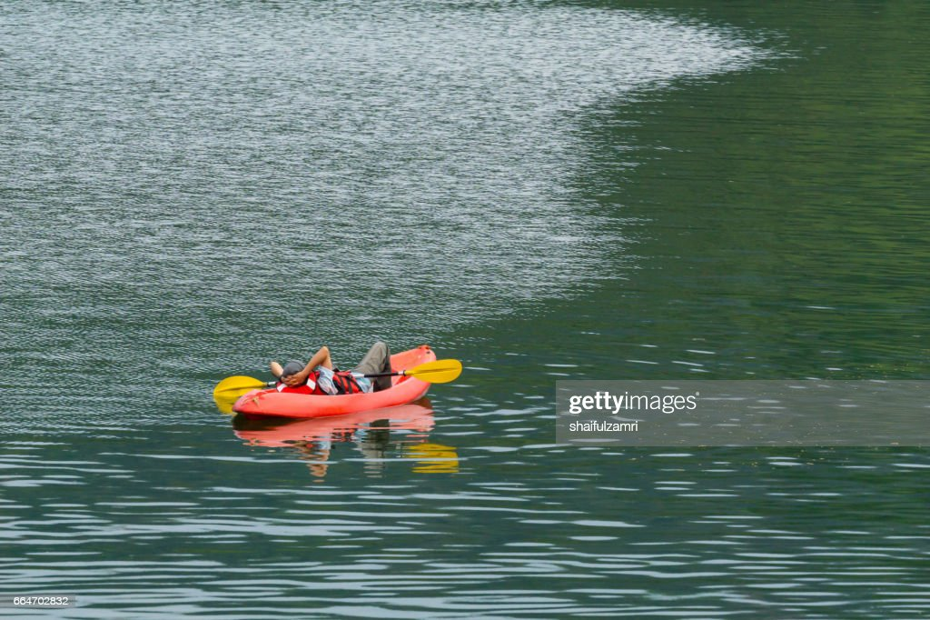 Local tourist pause a while during kayak for enjoying the beauty  of Royal Belum Rainforest park : Stock Photo