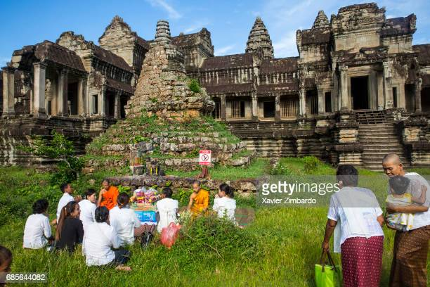 Local tourists and families praying and making offerings to Buddhist monks in the early morning on July 24 2016 at the UNESCO World Heritage site of...