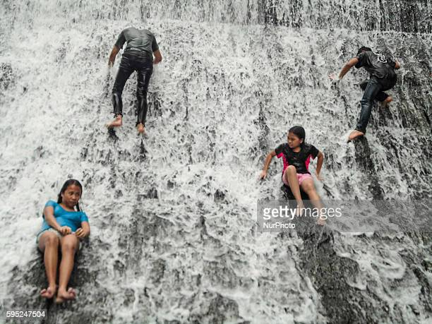 Local tourists bathe at the decommissioned Wawa Dam in the municipality of Rodriguez Rizal province on World Water Day 22 March 2016 The theme for...