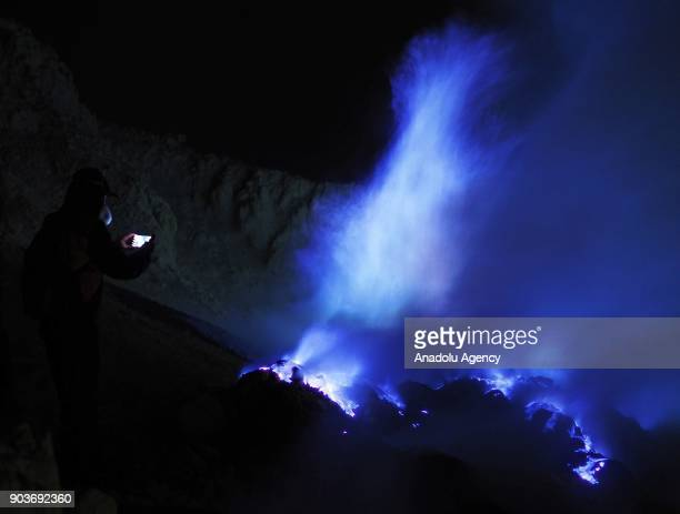 Local tourists visit the crater of Ijen volcano before sunrise to catch a glimpse of blue fire in Banyuwangi East Java Indonesia on January 11 2018...