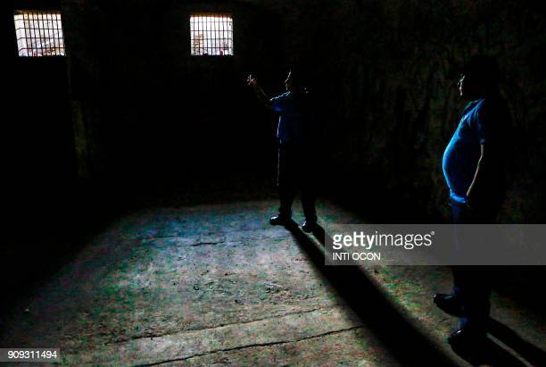 Local tourists walk inside Fortaleza's El Coyotepe tunnels in Masaya Nicaragua on January 16 2018 The fortress is an abandoned military structure...