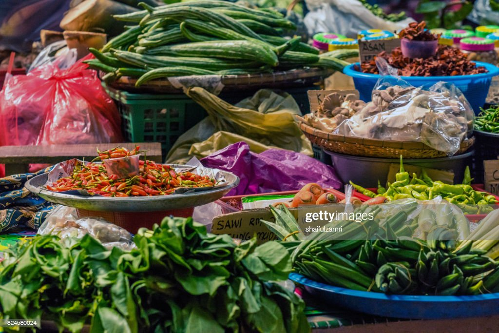 Local traders selling theirs goods and dried food  at Kota Bharu Main Market or famously known as Pasar Siti Khadijah in Kelantan State of Malaysia. : Stock Photo