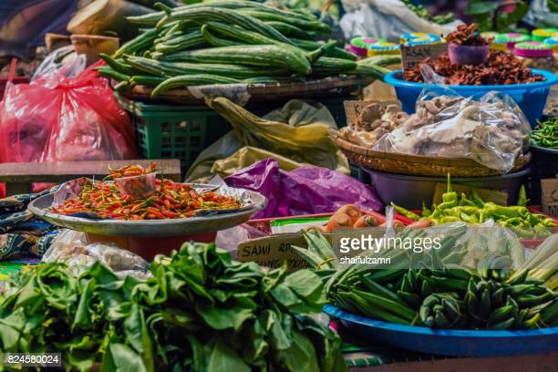 local traders selling theirs goods and dried food  at kota bharu main market or famously known as pasar siti khadijah in kelantan state of malaysia. - shaifulzamri stock pictures, royalty-free photos & images