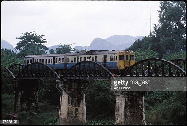 A local train passes over the infamous bridge over the River Kwai near Kanchanaburi Thailand 21st August 1983 Built by the Japanese military in 1943...