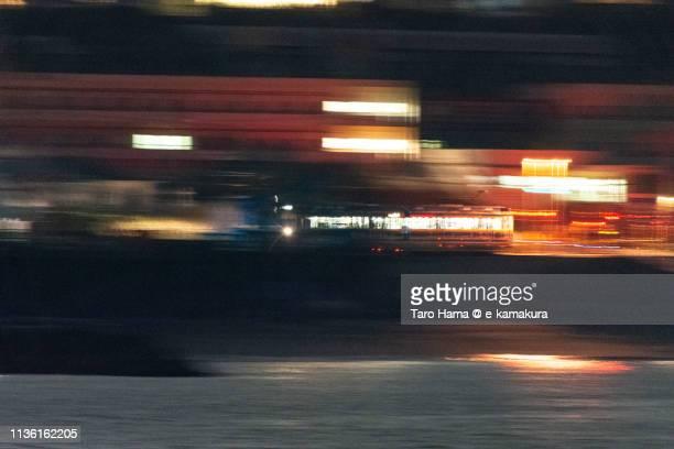 local train running by pacific ocean in japan - taro hama ストックフォトと画像