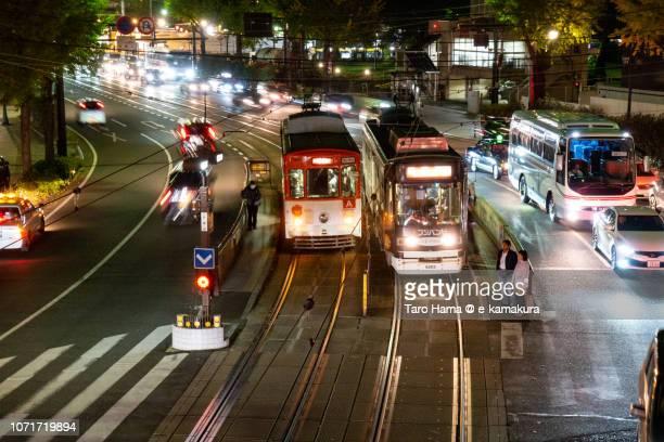 Local train running in center of Kumamoto city in Japan