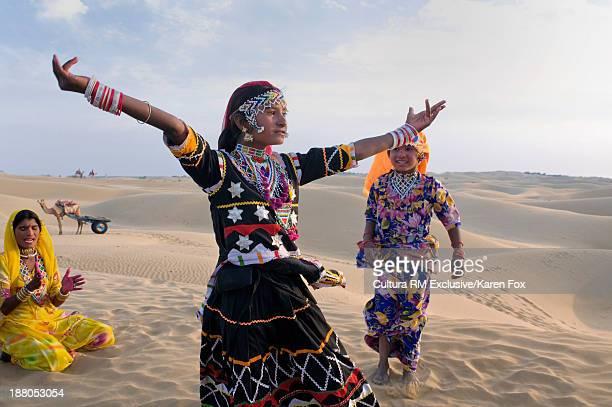 Local tribes women in Sam Sand Dunes near Jaisalmer, Rajasthan, India