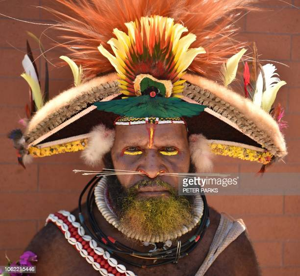 TOPSHOT A local tribesman waits to see China's President Xi Jinping during his visit to the Butuka Academy school in Port Moresby on November 16...