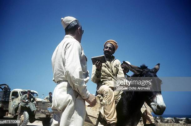 A local tribesmen on a donkey talks with the Colonel of the 376th Bombardment Group at the US Air Force Base in Benghazi Libya