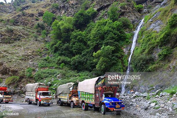 CONTENT] Local Trucks and their drivers at Mighty Karakorum Highway in Pakistan also known as Silk Road taking rest under the waterfall they...