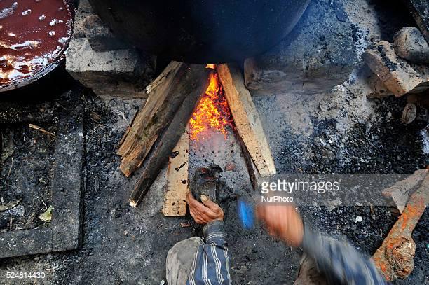 A local use manual machine fan to make fire to prepare molasses Chaku on 06 January 2015 at Tokha Kathmandu Nepal for the celebration of Maghe...