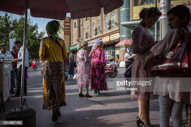 Local Uyghur women seen walking in the Kashgar old town, northwestern Xinjiang Uyghur Autonomous Region in China. Kashgar is located in the north...