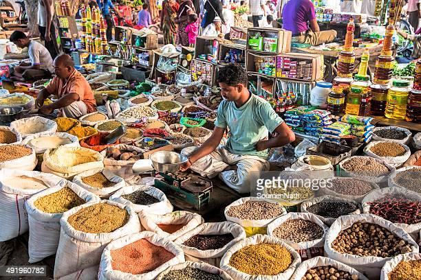 local vegetable and grocery market in india - india market stock photos and pictures