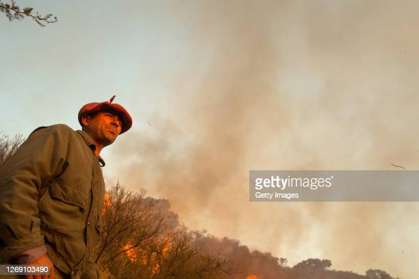 Local villager looks on as wildfires affect Casa Grande area on August 26, 2020 in Cordoba, Argentina. Wildfires are raging Argentina's Cordoba...