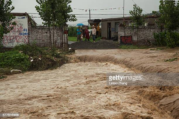 Local villagers await rescue are becoming trapped by flood waters on July 19 2016 at Linzhou Henan Province China Torrential rain has caused severe...