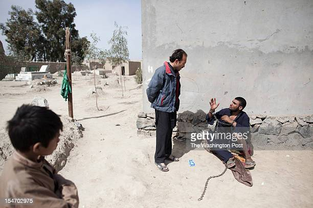 Local villagers come to stare at people suffering from a mental illness at the Mia Ali Sahib shrine outside Jalalabad Afghanistan on August 03 2012...