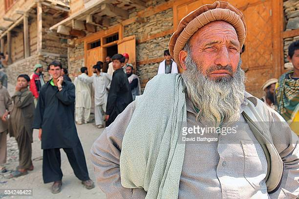Local villagers gather during a lull in the fighting at Barge Matal Nuristan province