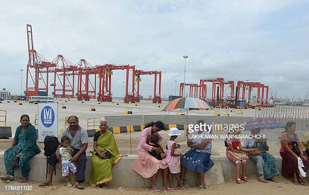 Local visitors are pictured on the premises of Sri Lankas latest mega port the Chinesebuilt Colombo International Container Terminal in Colombo on...