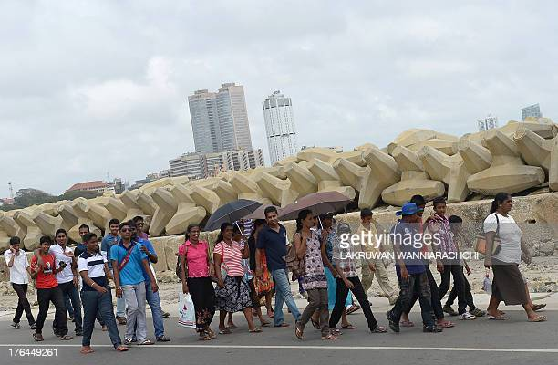 Local visitors walk on the premises of Sri Lankas latest mega port the Chinesebuilt Colombo International Container Terminal in Colombo on August 13...