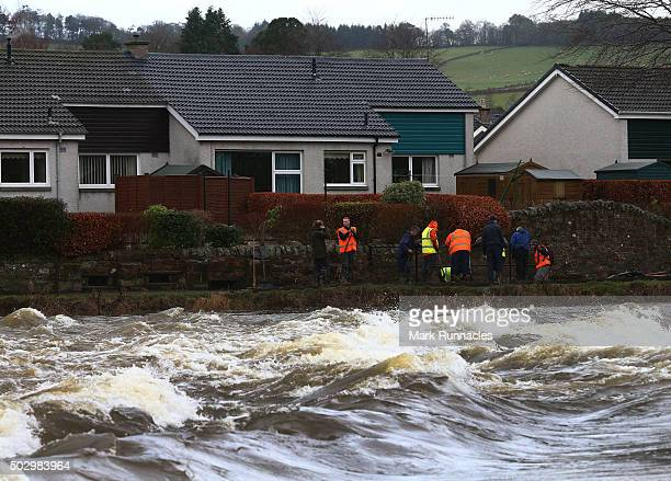 Local volunteers help to clear up the flood debris deposited after the river Tweed burst it's banks flooding the area on December 31 2015 in Peebles...