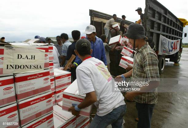 local volunteers unload relief supplies for refugees at the Indonesian military airport in Banda Aceh 10 January 2005 Donor countries pledged more...