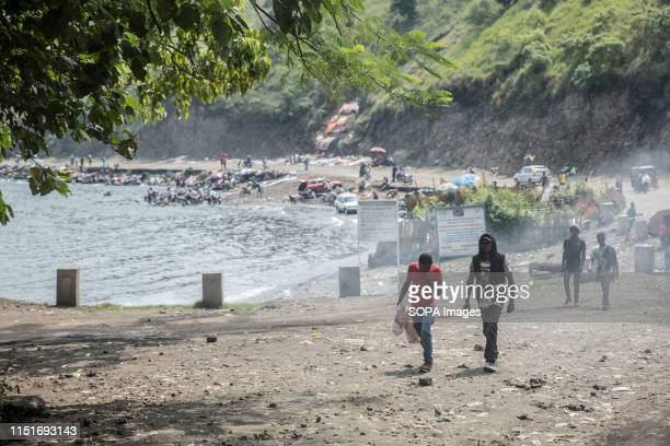 Local walk past the shores of Lake Kivu in Goma DR Congo is currently experiencing the second worst Ebola outbreak in recorded history More than 1400...