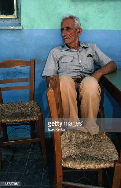 Local watching the world go by sitting in a taverna in Crete.