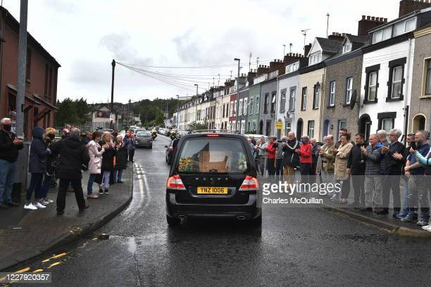 Local well wishers applaud the cortege of the late John Hume after his funeral at St Eugene's cathedral on August 5, 2020 in Londonderry, Northern...