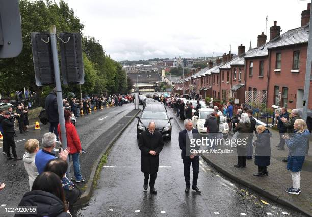 Local well wishers applaud the cortege of the late John Hume after the funeral of the former SDLP leader and Nobel Peace Prize winner at St Eugene's...