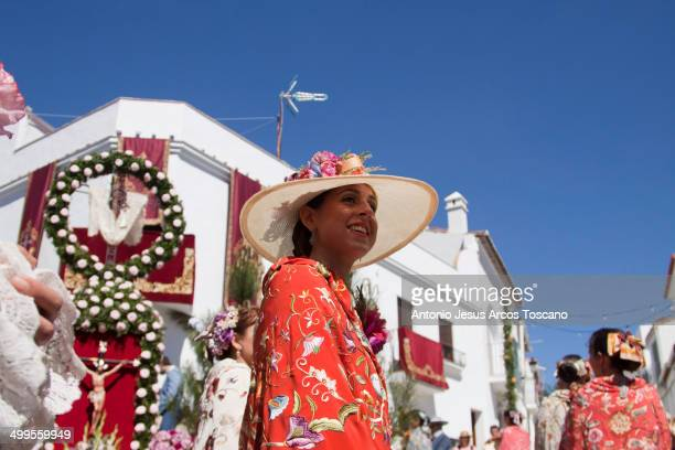 Local Woman Almonaster la Real, Huelva, paraded through the streets, passing in front of the Cruz de Mayo, dressed in the traditional embroidered...