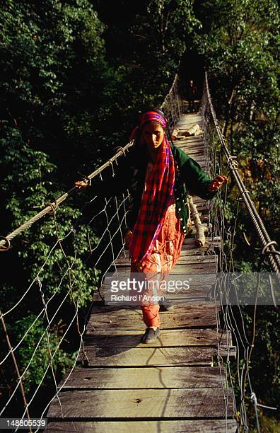 A local woman crossing the Linkhim bridge in the Kanchenjunga region.