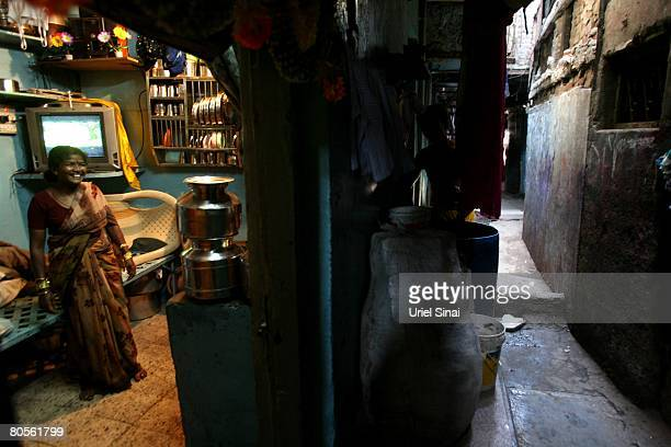 A local woman in her one room home at the Dharavi slum said to be 'Asia's largest slum' April 2008 in Mumbai India A city redevelopment program to...