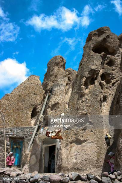 A local woman is seen as she walk through the village The tiny village of Kandovan in the Iranian East Azerbaijan Province is known for its cliff...