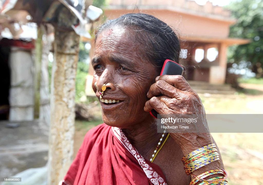 A local Woman joyfully shares the news of well being with her relatives after the cyclone Phailin on October 14, 2013 in Srikakulam, India. Cyclone Phailin on Sunday left a trail of destruction knocking down lakhs of homes affecting nearly 90 lakh people and destroying paddy crops worth about Rs 2,400 crore, but Odisha and Andhra Pradesh escaped from widespread loss of life due to timely and efficient evacuation efforts .