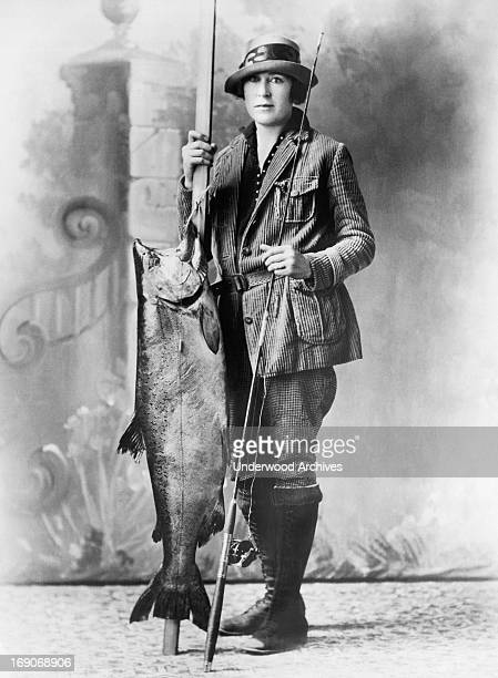 Local woman Mrs McKee poses with the biggest salmon caught this year, Goldendale, Washington, May 24, 1927. She got it on the Klickitat River and it...